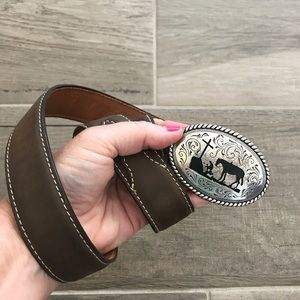 Nocona leather belt with cowboy and cross buckle